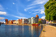 View of the riverside on Old Town by the Motlawa river in early morning light. Gdansk, Poland.