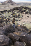 boy exploring an ancient volcano in the desert
