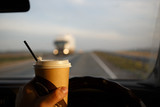 Drinking coffee while riding in the car. Emergency while eating at the wheel - 155105281