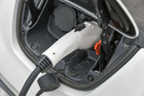 Charging an electric car closeup