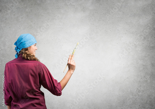 She is painting her world Poster