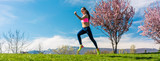 Woman sport running on hill for fitness with blossoming trees