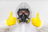 Man in coveralls with gas mask is showing positive gesture - 155177018