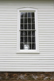 Old Grilled Window Pains and Wood Siding on Historic Little White Church