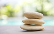 Closeup natural white zen stone over blurred background, spa decorate concept