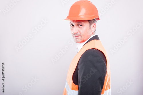 Side view of engineer wearing hardhat and reflective vest