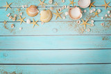 seashells and sand on wooden board - 155385279