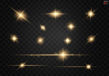Fototapety Set. Shining star, the sun particles and sparks with a highlight effect, golden bokeh lights glitter and sequins. On a dark background transparent. Vector, EPS10