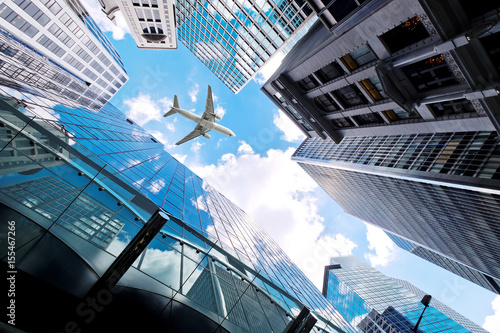 Airplane flying over business skyscrapers Poster