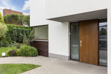 Wooden entrance door to modern house - 155469650