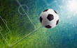 Soccer ball on green soccer field