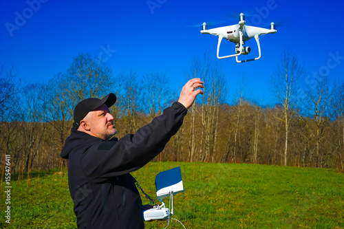 Juliste A man catches a drone when landing. Aviamodeli.