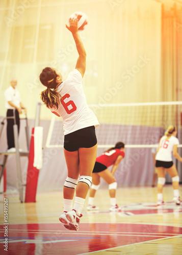 Fototapeta Anonymous woman playing volleyball