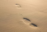 Close up of footprints on sand