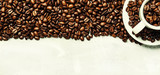 Roasted coffee beans in a white cup and saucer, gray food background, top view, flat lay