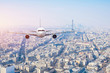 Airplane frying over the center of Paris, France
