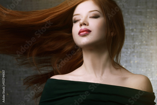 Girl with long hair. Studio portrait Poster