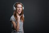 Expressive hilarious girl rocking new headphones