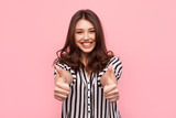 Smiling girl showing thumbs up - 155778050
