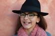 Smiling preteen girl wearing pink scarf