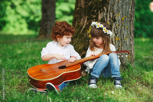 cute little children playing guitar Poster