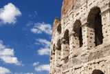 Coliseum monumental arches with blu sky in Rome