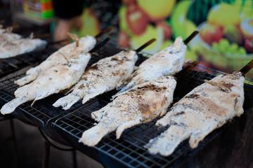 Preparing thai barbeque fish