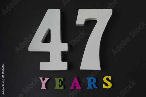 Poster Letters and numbers-forty-seven on a black background.