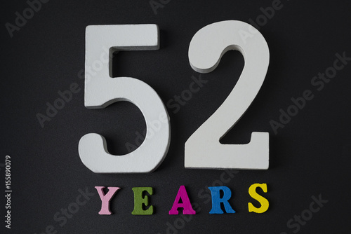 Poster Letters and numbers-fifty-two on a black background.