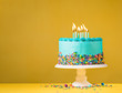 Blue Birthday Cake on Yellow