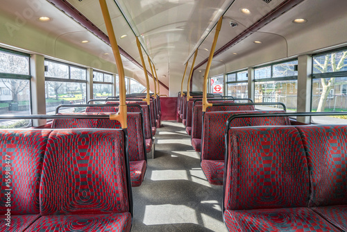 Empty seats in double decker bus Poster