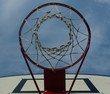A look at the blue sky through the basketball ring