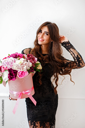 portrait of a beautiful girl on a white background with a basket of flowers Poster