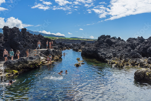 Plagát People swimming and enjoying summer in natural lava swimming pools, Terceira, Az