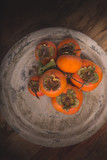 Fresh Persimmon on rustic stone background