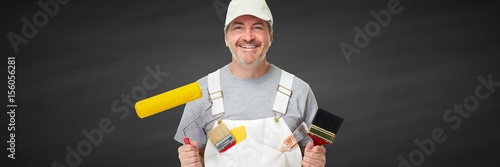 Smiling painter worker man