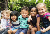 Fototapety Group of kindergarten kids friends arm around sitting and smiling fun