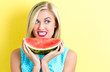 Happy young woman holding watermelon - 156078862