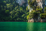 Magical landscape with green water and limestone mountain cliff