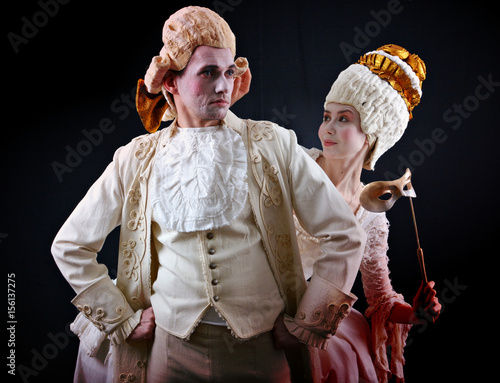 Man and woman in ancient costumes and white wigs Poster