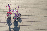 Kids tricycle in the street
