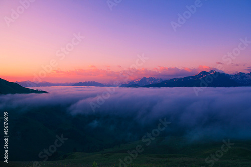 Foto op Canvas Lichtroze Sunset in the Caucasus mountains