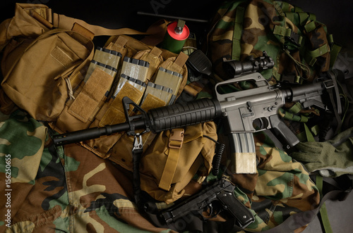 Fotobehang Jacht Assault rifle 5.56mm m16 Colt carbine with tactical chest rigs. Military Equipment.