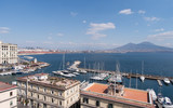 The Marina area with Mount Vesuvius in the background in Naples