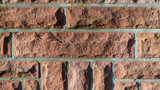 Red brick wall background texture closeup view