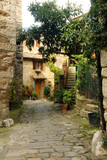 View of ancient stone street and home in Montefiroalle, Tuscany, Italy.