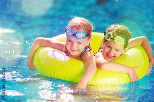 Kid in swimming pool.