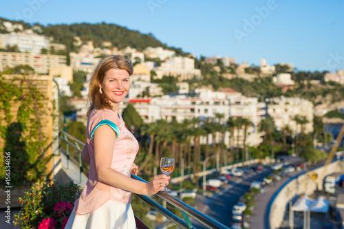 Fotobehang Nice Woman enjoying warm Mediterranean weather on balcony