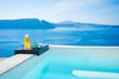 Swimming pool and refreshing orange juice and snacks