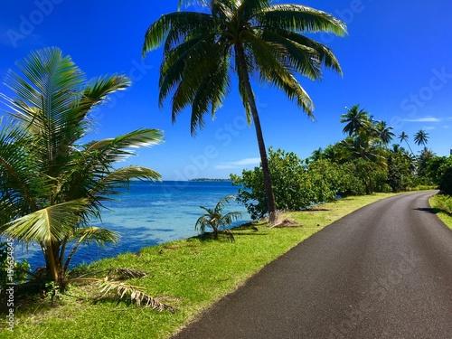 Plexiglas Donkerblauw Street along the coast and lagoon of Tahaa, Tahiti, French Polynesia